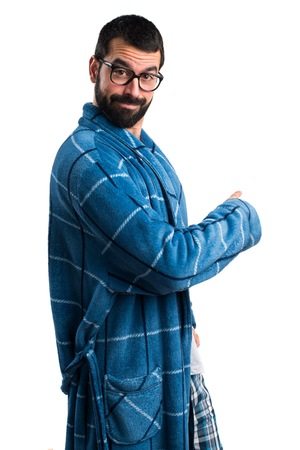 dressing gown: Man in dressing gown pointing back