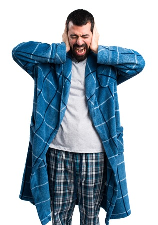 dressing gown: Man in dressing gown covering his ears