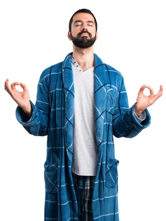 dressing gown: Man in dressing gown in zen position Stock Photo
