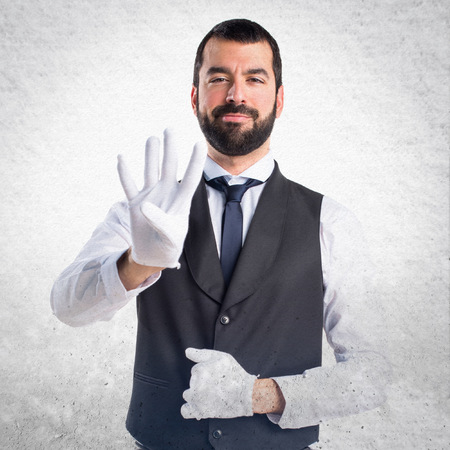 counting: Luxury waiter counting four Stock Photo