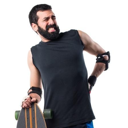 skater: Skater with back pain Stock Photo