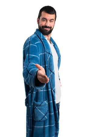 Man in dressing gown making a deal