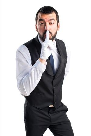 Luxury waiter making silence gesture