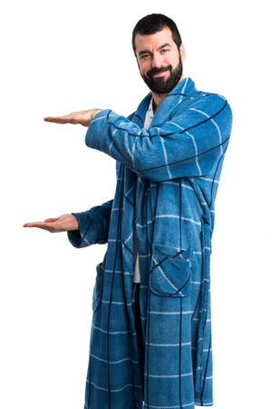 dressing gown: Man in dressing gown holding something