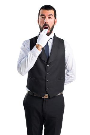 vomito: camarero de lujo haciendo el gesto de v�mitos Foto de archivo