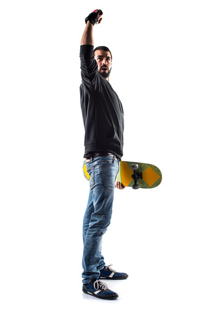 lucky man: Lucky man with skateboard Stock Photo