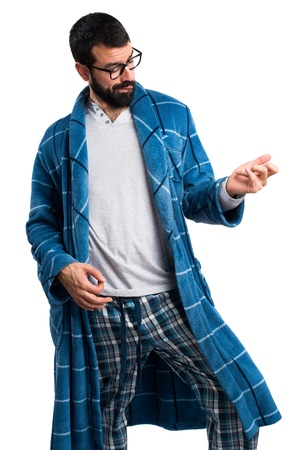 dressing gown: Man in dressing gown making guitar gesture