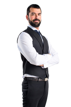 Luxury waiter with his arms crossed