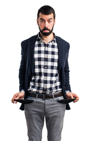 empty pocket: Ruined man looking money in their pockets Stock Photo