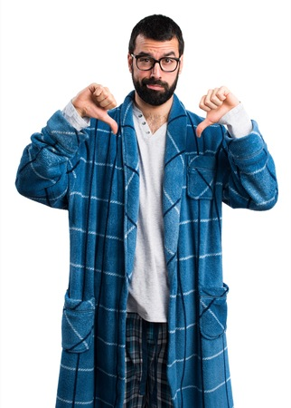 dressing gown: Man in dressing gown doing bad signal Stock Photo