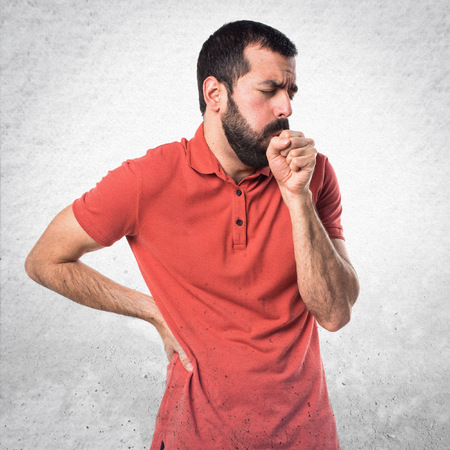 coughing: Handsome man coughing a lot Stock Photo