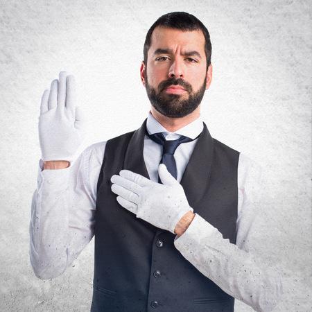 oath: Luxury waiter doing oath