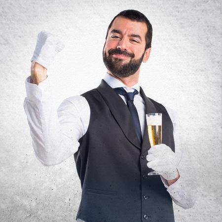 winner man: Lucky luxury waiter with champagne Stock Photo