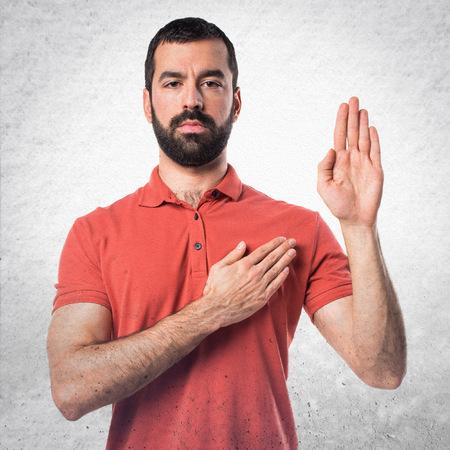 Handsome man doing oath