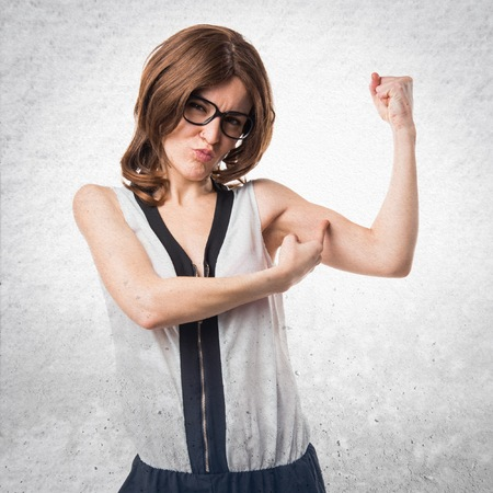 strong: Brunette woman making strong gesture