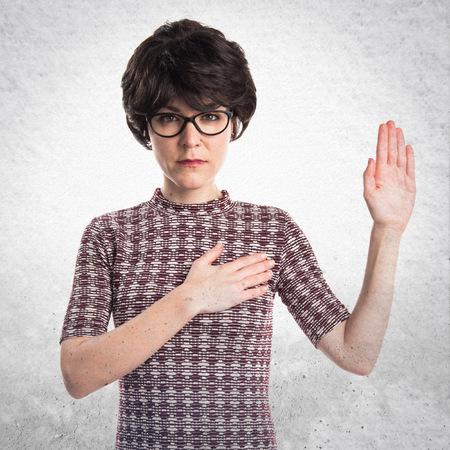 oath: Girl doing oath Stock Photo