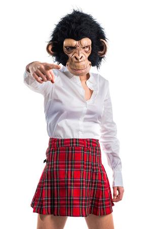 animal woman: Girl with monkey mask Stock Photo
