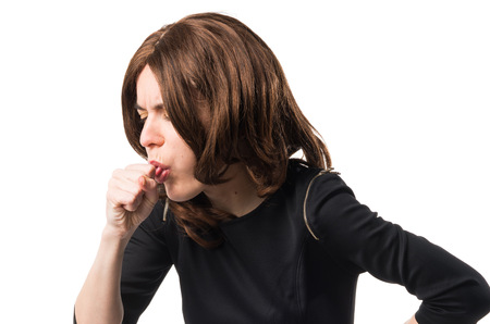 Brunette woman coughing a lot Stock Photo