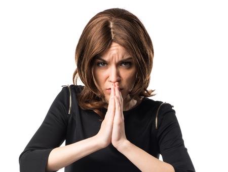 pleading: Brunette woman pleading Stock Photo
