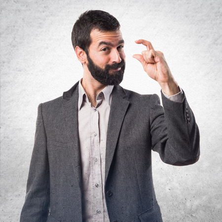 tiny: Man doing tiny sign