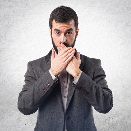 covering: Man covering his mouth Stock Photo