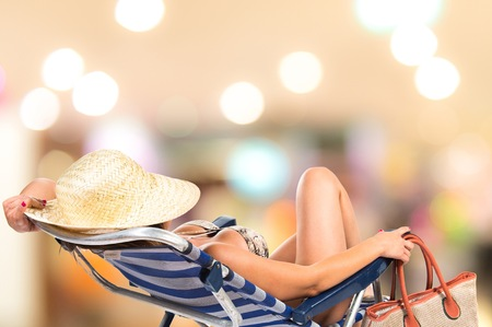 Woman resting on beach chair Stock Photo