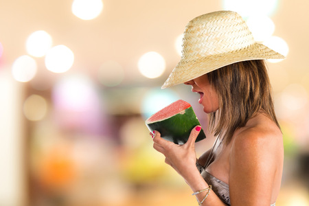 summer diet: Woman in bikini eating a watermelon