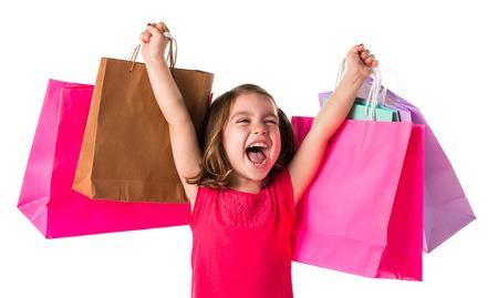 ni�o modelo: Chica con muchas bolsas de la compra