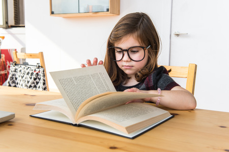 hispanic kids: Little kid reading a book