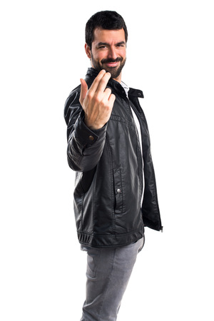 Man with leather jacket coming gesture
