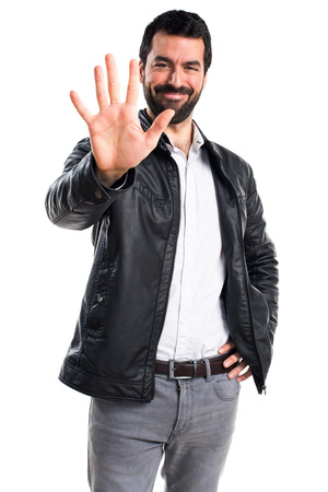 counting five: Man with leather jacket counting five