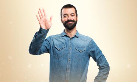 waving: Man saluting Stock Photo
