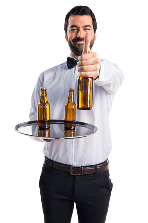 hotel staff: Waiter with beer bottles on the tray
