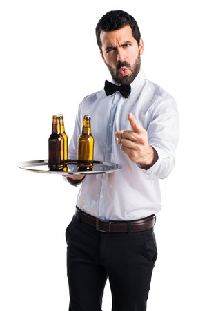 personne en colere: Waiter with beer bottles on the tray shouting