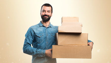 cargo container: Man holding boxes