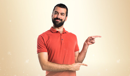 lateral: Handsome man pointing to the lateral Stock Photo