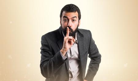 silence gesture: Man making silence gesture
