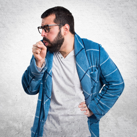 dressing gown: Man in dressing gown coughing a lot Stock Photo