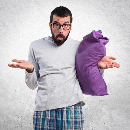 unimportant: Man in pajamas making unimportant gesture Stock Photo