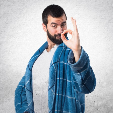 dressing gown: Man in dressing gown making OK sign