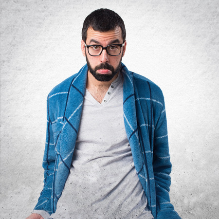 dressing gown: Ruined man in dressing gown looking money in their pockets Stock Photo