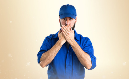 covering: Plumber covering his mouth