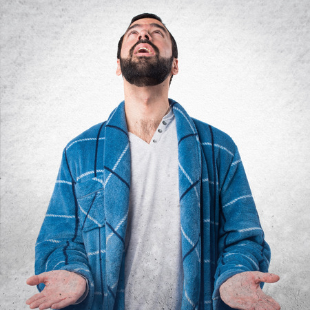 dressing gown: Man in dressing gown pleading Stock Photo