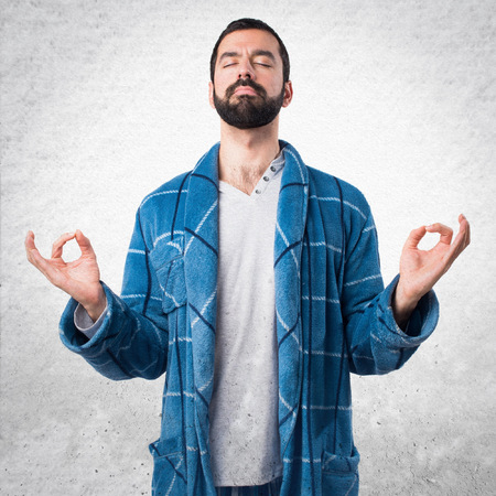 yoga pillows: Man in dressing gown in zen position Stock Photo