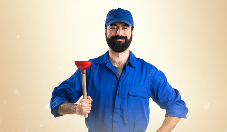plunger: Plumber holding a plunger Stock Photo