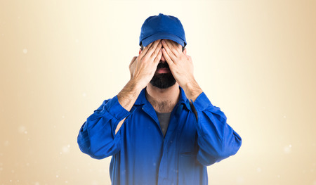covering: Plumber covering his eyes
