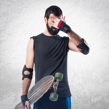 covering: Skater covering his face Stock Photo