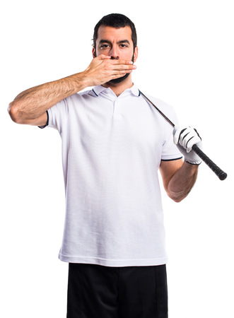 covering: Golfer covering his mouth Stock Photo