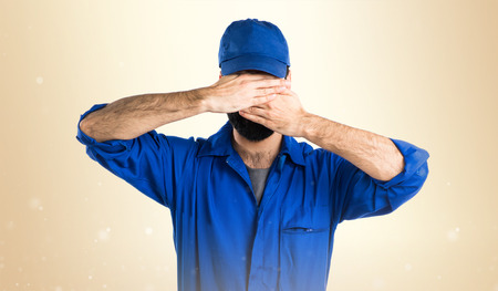 covering: Plumber covering his face
