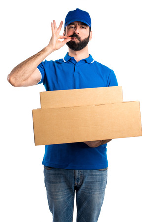 silence gesture: Delivery man making silence gesture